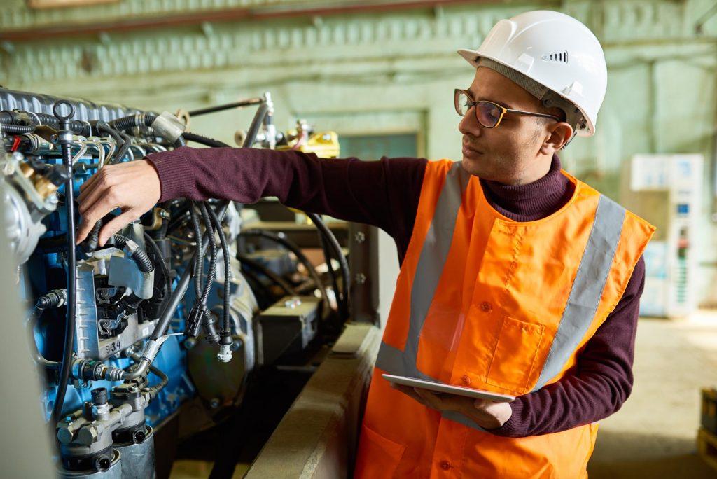 handsome-technician-adjusting-engine-features-ER6YTHV.jpg