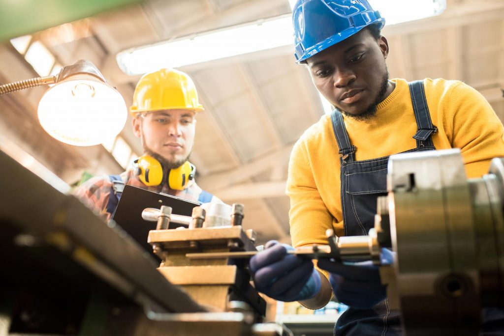 inspector-evaluating-work-of-repairing-engineer-at-YANT7M5.jpg